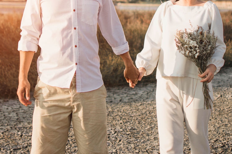 Couple Dress Holding Hands Love Married Relationship Romantic Body Part Couple Love Dry Female Hand Holding Hands Human Hand Love Male Marriage  Pre Wedding Real People Togetherness Togheter Two People Vintage Vintage Tone White