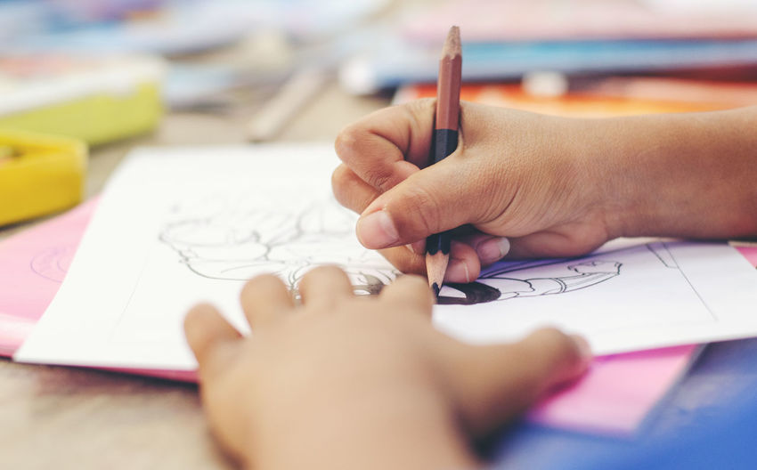 Human Hand Hand Human Body Part Art And Craft Creativity Paper Drawing - Activity One Person Indoors  Holding Pen Drawing - Art Product Close-up Selective Focus Pencil Activity Table Body Part Writing Human Limb Note Pad