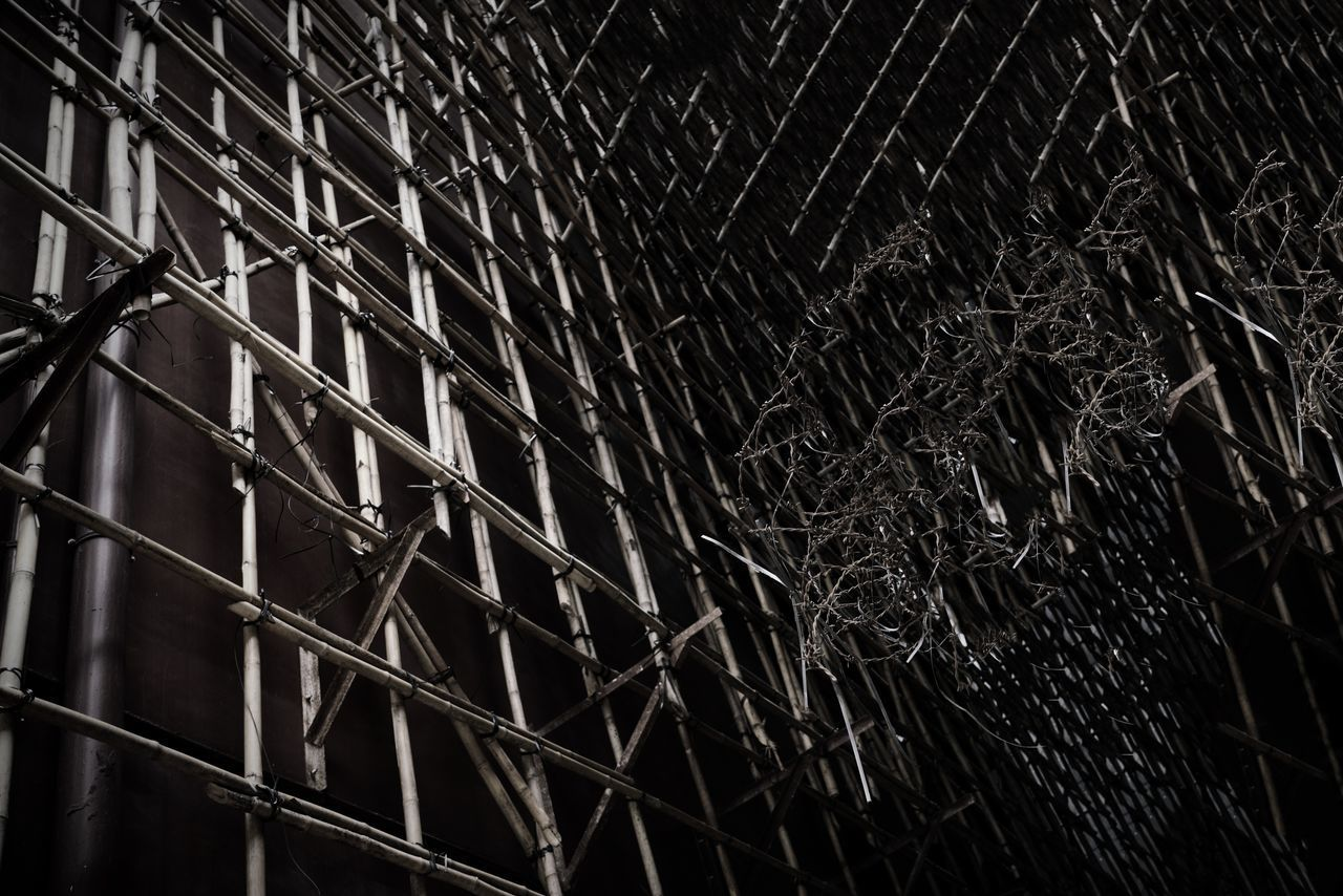 no people, metal, backgrounds, full frame, pattern, close-up, night, low angle view, outdoors, built structure, safety, fence, security, nature, textured, barrier, architecture, boundary, complexity, steel, tangled