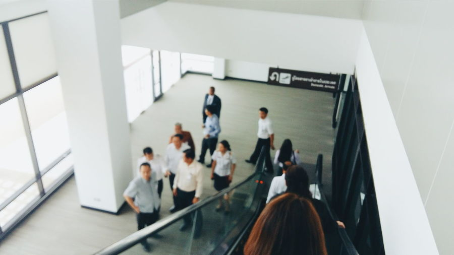 High angle view of people by escalator in modern building
