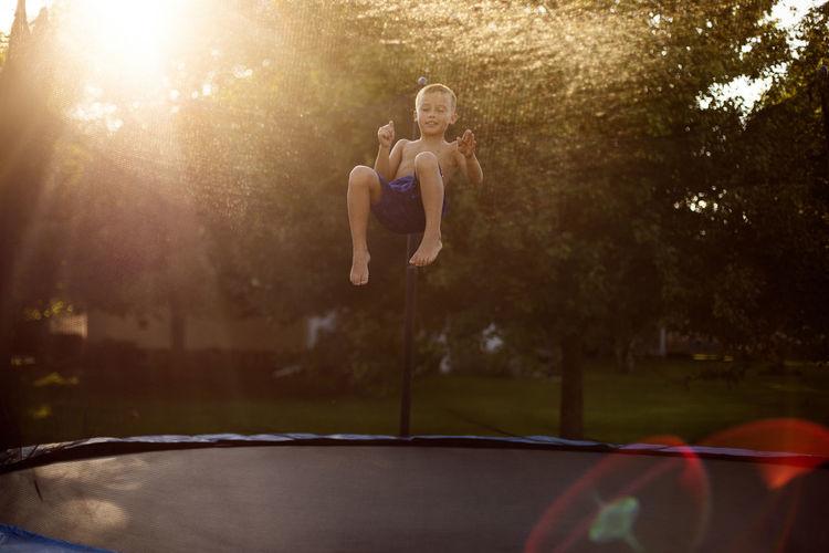 Boy jumping on
