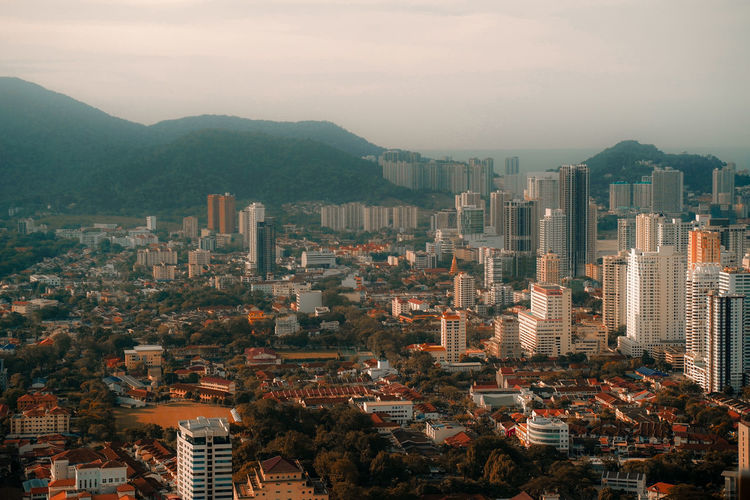 Penang, Malaysia Aerial View City Cityscape Urban Skyline Skyscraper Modern Illuminated Downtown District Sunset Business Finance And Industry Aerial View Urban Sprawl Human Settlement Tall - High TOWNSCAPE Rooftop