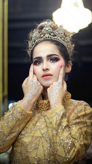 Portrait of beautiful model wearing crown