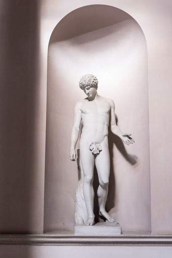 Statue against wall
