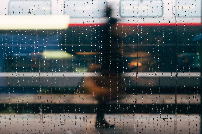 The traveler Wet Drop Glass - Material Window Rain One Person Transparent The Street Photographer - 2018 EyeEm Awards
