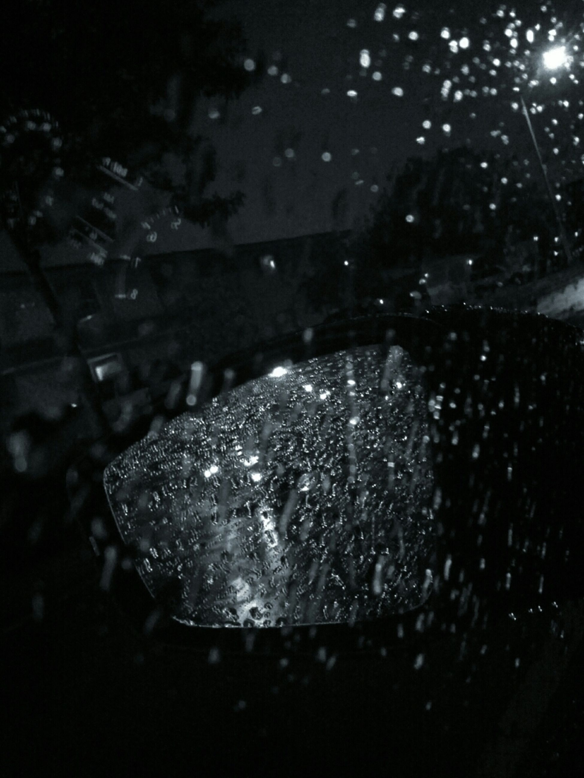 night, water, drop, wet, close-up, rain, illuminated, season, focus on foreground, dark, raindrop, selective focus, nature, indoors, weather, no people, monsoon, reflection, high angle view