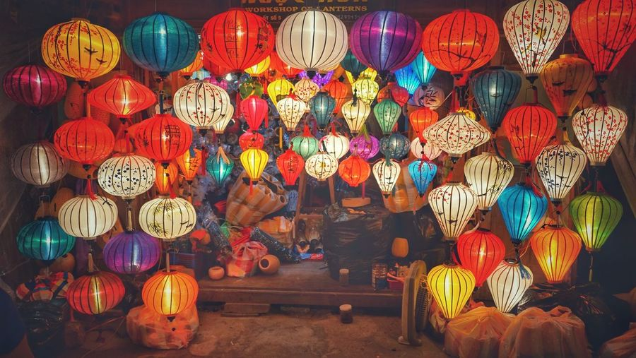 Illuminated lanterns hanging for sale at market