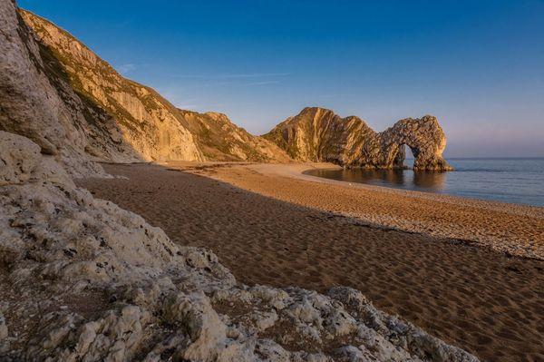 Durdle Door at sunset Limestone Arch Seascape Photography Seaside Beach Southwest Coast Dorset Uk Golden Hour Golden Landscape Cliffs Uk Jurrasic Coast Purbeck The Great Outdoors - 2017 EyeEm Awards