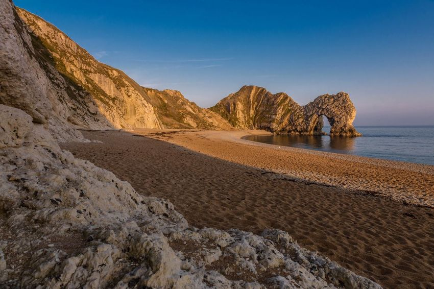 Durdle Door at sunset Limestone Arch Seascape Photography Seaside Beach Southwest Coast Dorset Uk Golden Hour Golden Landscape Cliffs Uk Jurrasic Coast Purbeck The Great Outdoors - 2017 EyeEm Awards