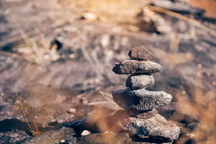 Balance Beauty In Nature Close-up Day Field Focus On Foreground High Angle View Land Nature No People Outdoors Pebble Rock Rock - Object Selective Focus Solid Stack Stone - Object Sunlight Tranquility Zen-like
