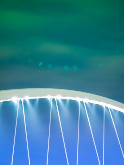 Green and blue, with flare Light Night Architecture_collection Architecture Bridge Green Blue Arts Culture And Entertainment No People Outdoors Amusement Park Day Sport Amusement Park Ride Nature Sky AI Now The Graphic City The Graphic City
