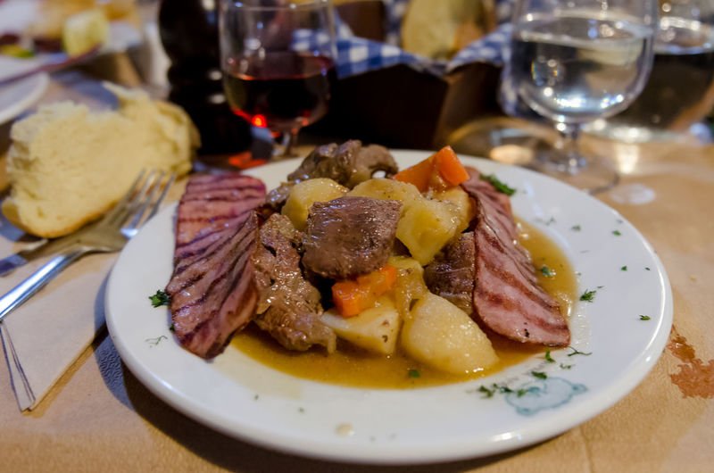 Roe stew with bacon Cuisine Greek Parnassus Arachova Bacon Close-up Food Food And Drink Greece Indoors  Meat No People Parnassos Plate Potatoes Ready-to-eat Roe Deer Roebuck Stew Table Traditional Wild Wine Wineglass