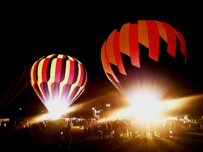 Illuminated hot air balloon against sky at night