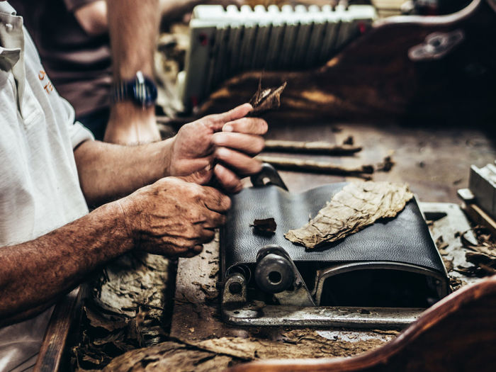 Art And Craft Craft Expertise Hand Holding Human Body Part Human Hand Indoors  Making Men Occupation One Person Real People Skill  Technology Work Tool Working Workshop