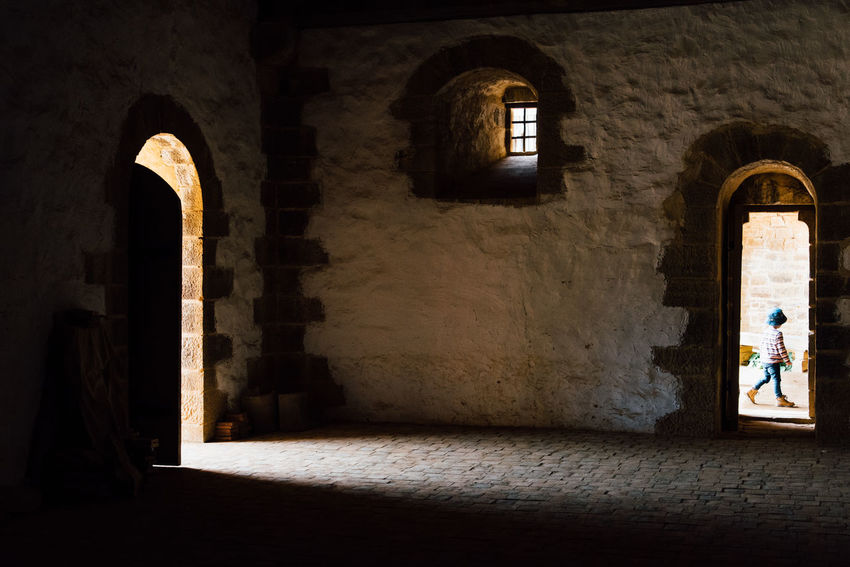 Alone Castle The Past Child Visiting Arch Architecture Built Structure Historic History Historic Building Fortress Ancient Fort Passageway Archway Fortified Wall