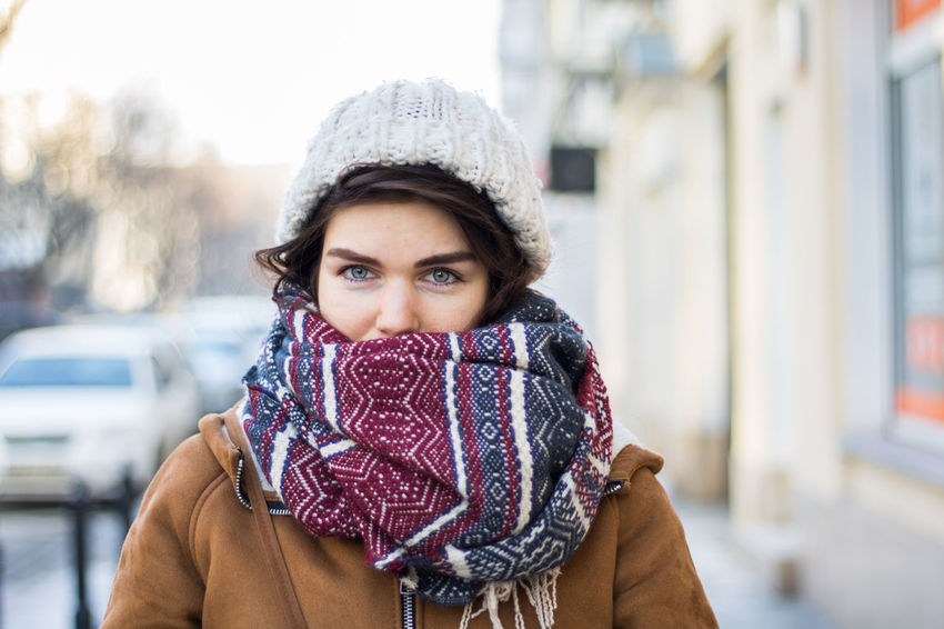 Warm Clothing Winter One Woman Only Portrait Looking At Camera Only Women Women Beautiful People Young Adult Outdoors Cold Temperature Headshot Beautiful Woman Adults Only Scarf Adult Beauty Winter Coat Fashion People Vibrant Color Uniqueness Blue Eyes Portrait Of A Woman