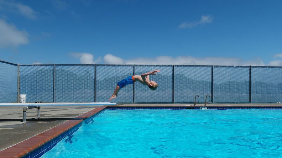 The Colour Of Sport Pool Poolside Swimming Swimming Pool Blue Blue Sky Backflip Diving Board Jumping Childhood Diving Simplicity Copy Space Blank Space Colour Of Life Color Palette My Year My View Enjoy The New Normal Live For The Story Summer Exploratorium Summer Sports