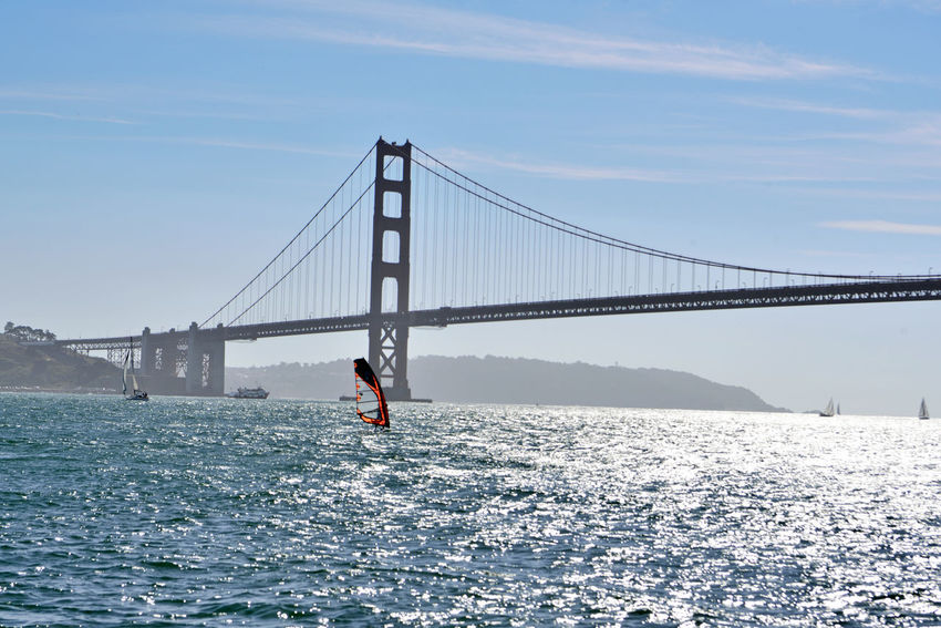 Sailing Past The Golden Gate Bridge 8 Windsurfer Windsurfing Sailboat Ferry Sailing San Francisco Bay Golden Gate Bridge South Anchorage Fort Point Silhouettes Hills Of San Francisco Eastbay Hills Seascape Riding The Winds Landscape_Collection Landscape_photography Nature Nature_collection Beauty In Nature A Day On The Bay Enjoying Life Foggy Scenics Horizon Over Water Tranquility