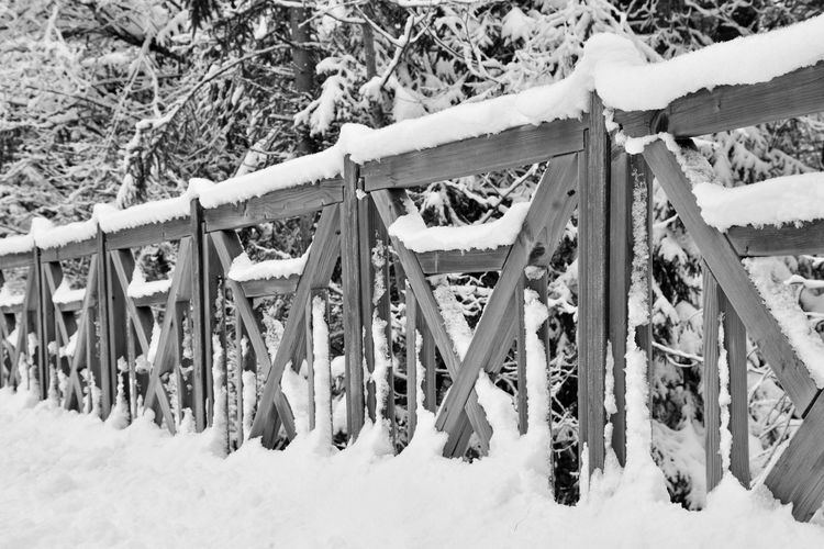 Snow hanging on clothesline in winter