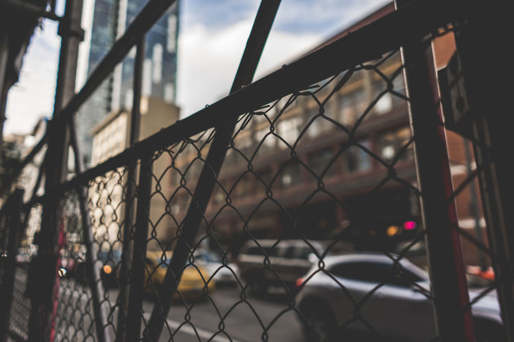 Close-up of chainlink fence against sky