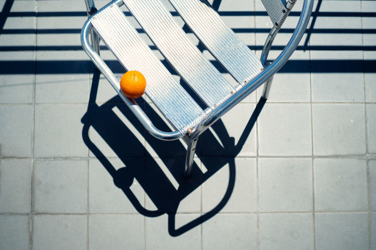 at the beach (breakfast) Food Stories Chair Orange Porto Shadows & Lights Sunshine ☀ Aluminium Close-up Day Fivedaysporto Minimalism No People Orange - Fruit Shadow Summer Sunshine Tiles Mix Yourself A Good Time Rethink Things