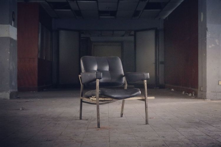 Empty chairs in abandoned room
