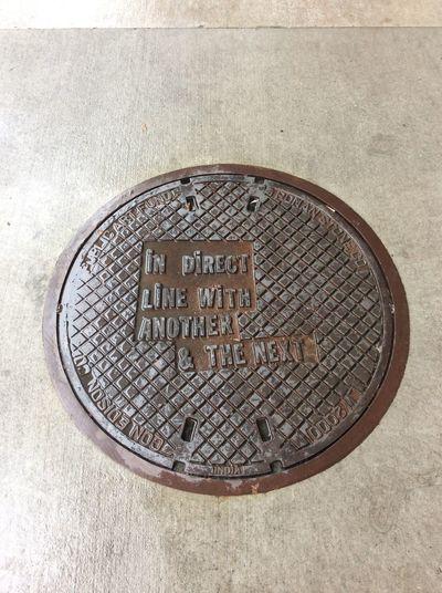 New York USA Iron Manhole Cover Concrete Sidewalk The Witney Museum Of American Art November grey day