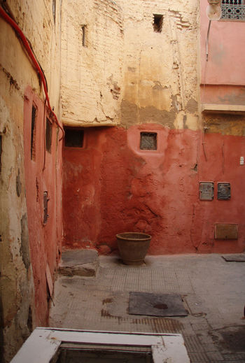 Adventure Africa Architecture Earth Tones Empty House Marrakech Medina Morocco Natural Old Quiet Red Stone Wall Tan Textured  Travel Walking Around Wall Warm Colors Weathered Windows