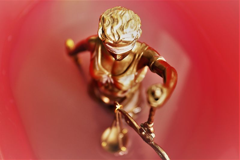 Close-up of lady justice sculpture on table
