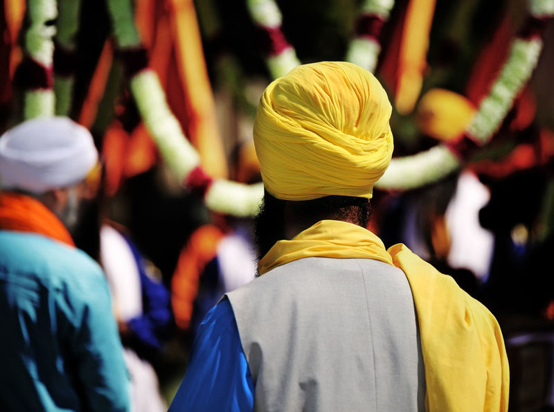 Sikh man with yellow turban and long black beard during the religious rite Celebration HEAD India Indian Indian Culture  Man Sikhi Vivid Colours  Clothing Nagar Kirtan Nagarkirtan  Parade People Religion Religious  Religious Rites Rite Sikh Sikh People Sikh Religion Sikhism Sikhlife Sikhs Turban Turbans