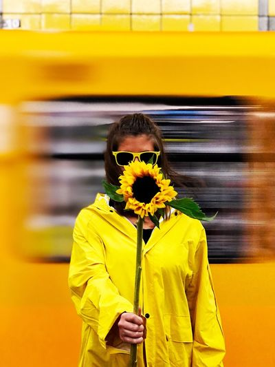 Paint The Town Yellow Yellow Real People Lifestyles One Person Flower Transportation Public Transportation Front View Mode Of Transport Train - Vehicle Casual Clothing Day Leisure Activity Standing Subway Train Nature Young Adult People Girl