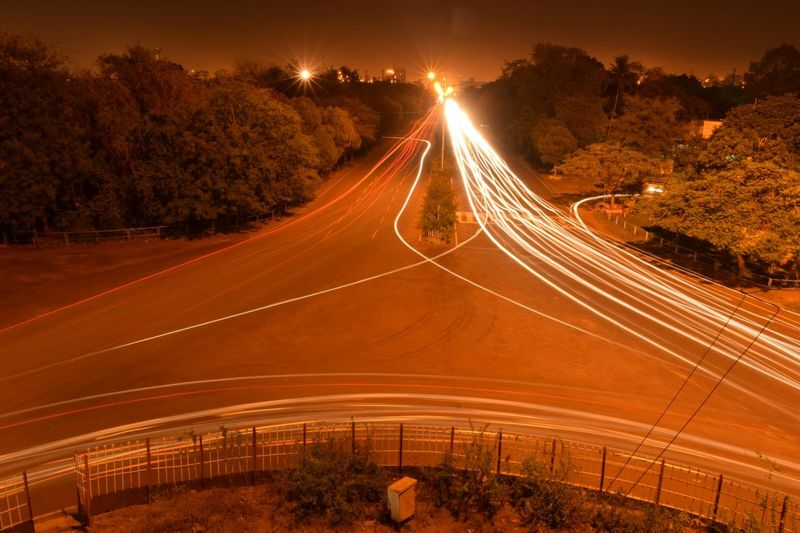 Light Trails Of Moving Traffic On Road At Night