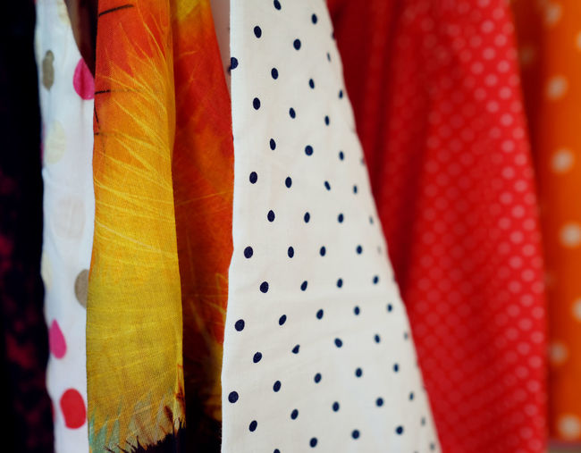 Choice Close-up Clothing Day Dress Fashion Garment Hanging In A Row Indoors  Multi Colored No People Pattern Polka Dot Red Scarf Spotted Still Life Store Textile Variation White Color