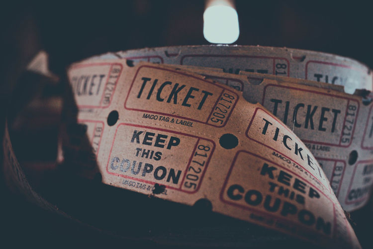 Roll of old vintage coupons. Antique Box Carnival Classic Cut Entry Event Life MOVIE Pass Print Retro Access Aged Amusement Park Ride Black Carnival-rides Cinema Coupons Entertainment Fair Festival Hipster Movie-ticket Vintage