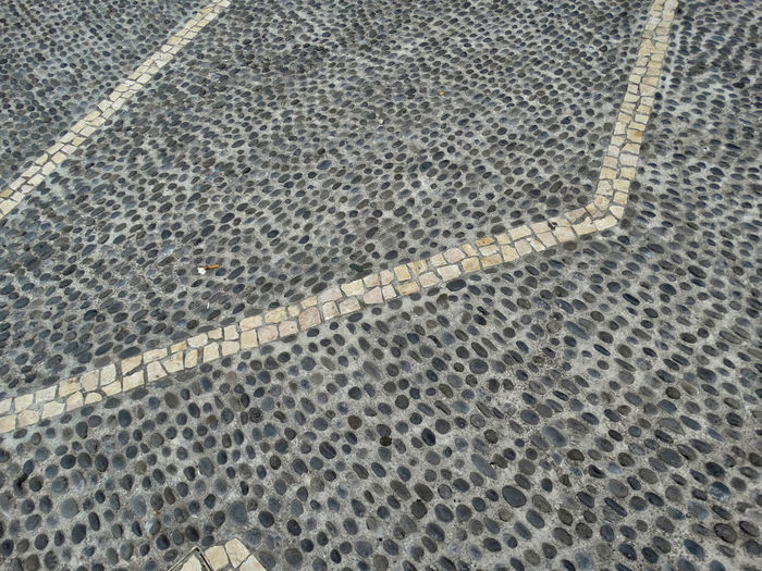 Cobbled flooring. High Angle View Pattern Full Frame Backgrounds No People Textured  Flooring Tiled Floor Tile Day Footpath Nature Outdoors Street City Shape Design Gray Architecture Paving Stone Textured Effect Cobblestone Cobblestone Streets
