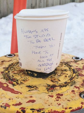 """I feel like this is ironic, """"humans are too stupid to be real, then you have to look at all the garbage they leave behind"""" - a seemingly troubled or angry stranger Garbage On A Fire Hydrant Discarded Paper Coffee Cup Poetry ? Poetic Irony Hidden Note Negative Vibes"""