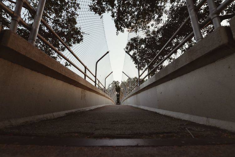 Pedestrian bridge. Low Angle View Pedestrian Walkway Bridge Streetphotography Direction The Way Forward Diminishing Perspective Architecture Day Built Structure Nature Outdoors Transportation vanishing point Railing Sky