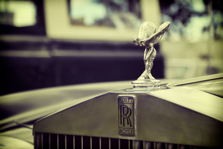 The Spirit of Ecstasy hood emblem perched on the radiator grille of a classic Rolls Royce motor car. Automotive Hanging Out Hood - Clothing Hood Emblem Luxury Luxurylifestyle  Rolls Royce Spirit Of Ecstasy