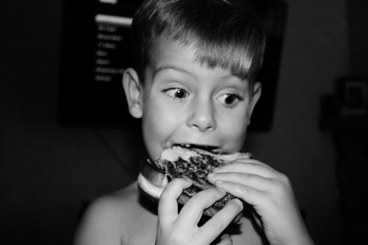 Close-up of boy eating food