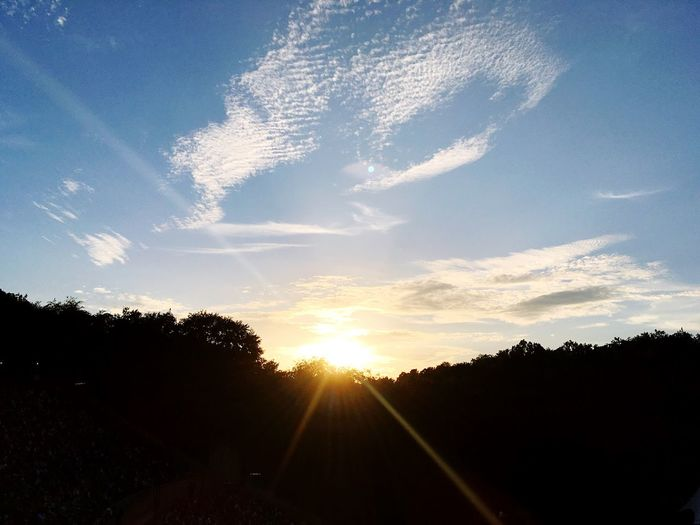 Sun Sunset Silhouette Sunlight Sunbeam Tranquil Scene Scenics Tree Beauty In Nature Sky Landscape Tranquility Idyllic Nature Outline Lens Flare Cloud Bright Growth Outdoors Remote Solitude Calm Cloud - Sky
