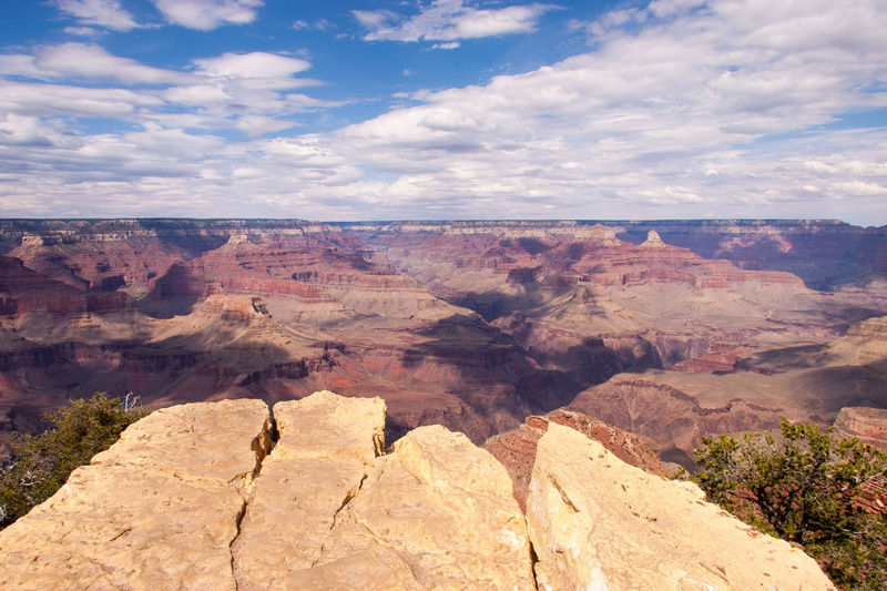 Beautiful view of the Grand Canyon from the south rim EyeEmNewHere Grand Canyon Beauty In Nature Canyon Cloud - Sky Environment Eroded Formation Geology Idyllic Landscape Mountain Mountain Range Nature No People Non-urban Scene Outdoors Rock Rock - Object Rock Formation Scenics - Nature Sky Solid Tranquil Scene Tranquility Travel Destinations Wallpaper Rock