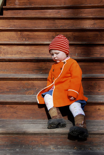 A young baby girl sitting outside in the sun at the staircase. Child Childhood Cute Day Innocence One Person Outdoors Staircase