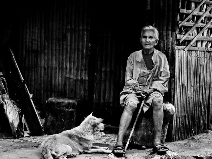 Senior Adult One Person Pet Owner Pet Doglover People Portrait Sitting Outdoors Lifestyles Real People Documentary Photo People Photography Eyeem Philippines Urban Scene Monochrome Photography Monochrome Street Photography Streetphotography Black And White Photography Blackandwhite Street Photography Lines And Patterns Animal Themes Classic Style