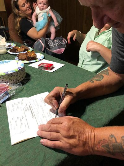 Signing the Marriage License Togetherness We Had Marriage License Togetherness Celebration Dinner Indoors Close-up Day Human Hand In Light Old Fashion Wedding EyeEm Selects Real People Table People Men Group Of People Leisure Activity