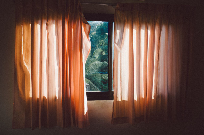 Curtain hanging from window at home