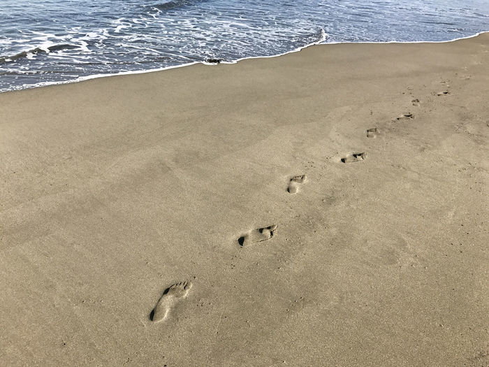 Footprints in sand on beach Beach Beauty In Nature Day Foodprint FootPrint Nature No People Outdoors Sand Sea Water