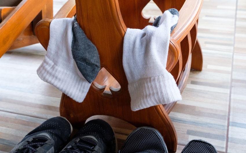 Close-up of socks hanging on furniture