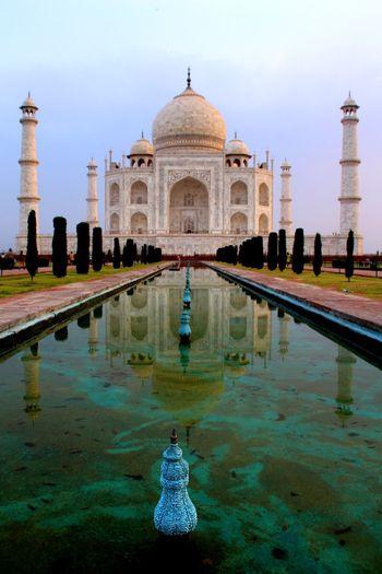 Reflection view of taj mahal against sky
