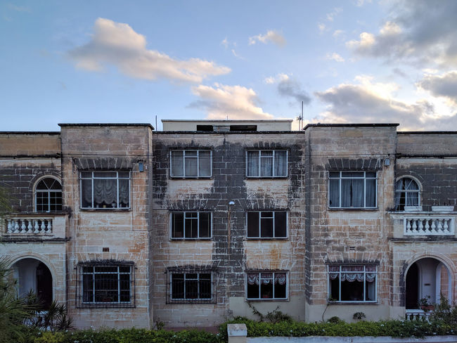 Abandoned Architecture Building Exterior Built Structure Cloud - Sky Dark Windows Day No People Outdoors Sky Spooky Symmetrical Window