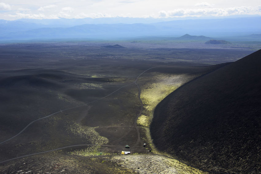 Camp at the foot of hills from volcanic sand Aerial View Agriculture Beauty In Nature Day Far East Kamchatka Landscape Mountain Nature No People Outdoors Road Russia Scenics Tranquility Winding Road